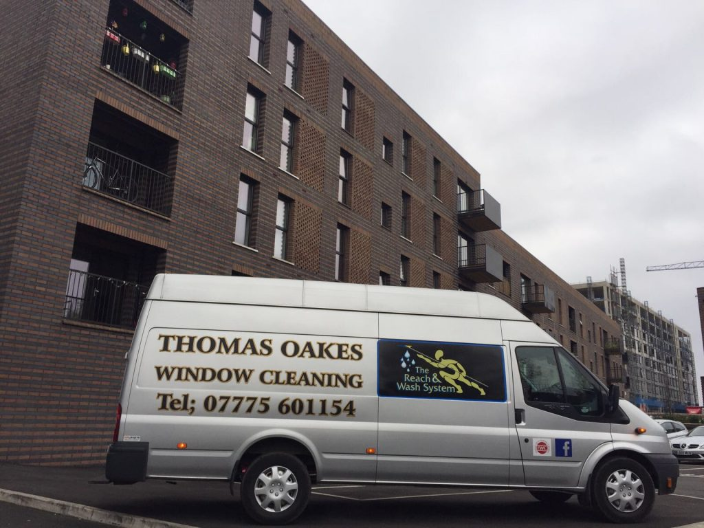 thomas oakes window cleaning van infront of building